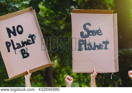 Group Of Activists With Banners Protesting Over Pollution And Global Warming Doing A Silent Protest