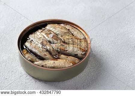 Baltic Sprats In An Tin Can On A Light Gray Background. Close-up