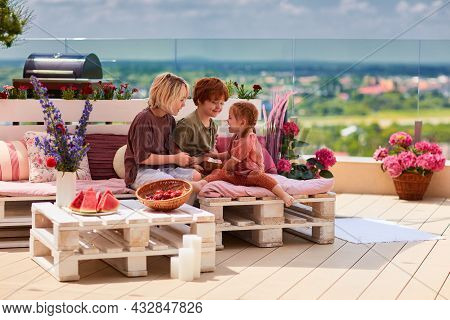 Cheerful Kids, Siblings Having Fun, Playing Together On Pallet Lounge Furniture At The Rooftop Patio