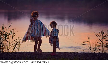 Cute Children, Siblings Having Fun By The Lake At Warm Summer Evening