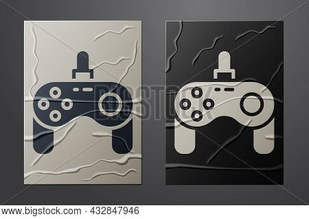 White Gamepad Icon Isolated On Crumpled Paper Background. Game Controller. Paper Art Style. Vector