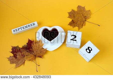 Calendar For September 28 : The Name Of The Month In English, Cubes With The Number 28,a White Heart