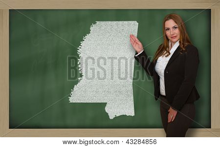 Teacher Showing Map Of Mississippi On Blackboard