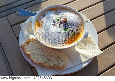 Vegetable Soup With Fresh Sprouts And Foam Garnish As Appetizer At A Garden Party Menu On A Wooden T