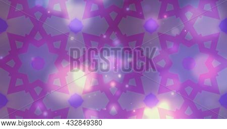 Image of kaleidoscopic colourful pink and purple shapes moving hypnotically in a seamless loop over floating glowing lights. Colour, light and movement concept digitally generated image