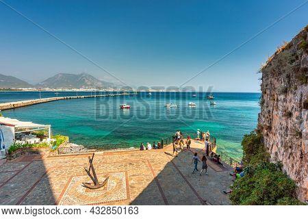Alanya, Turkey - July 21, 2021: Tourists in the port of Alanya on the Mediterranean Sea, Turkey.