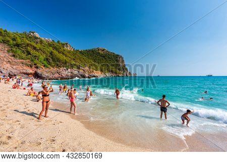 Alanya, Turkey - July 21, 2021: Tourists on the Cleopatra Beach of Alanya at the Mediterranean Sea, Turkey.
