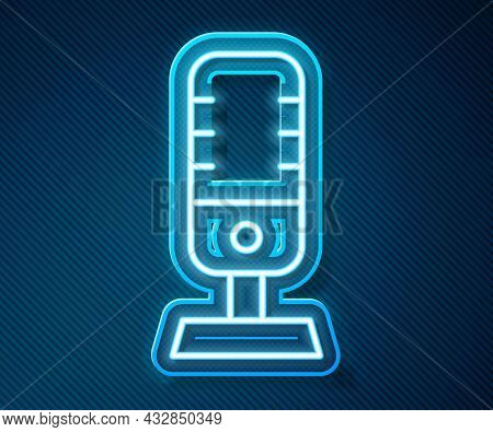 Glowing Neon Line Microphone Icon Isolated On Blue Background. On Air Radio Mic Microphone. Speaker