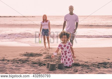 Child Playing On The Beach On Summer Holidays. Kid  Building A Sandcastle At Sea. Family And Holiday