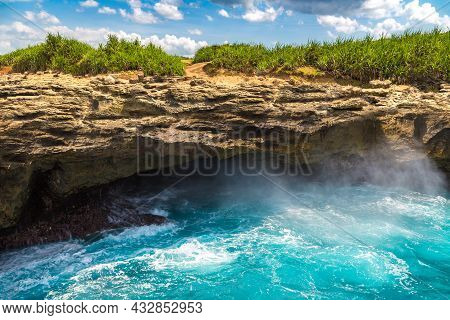 Devil's Tear At Nusa Lembongan Island In A Sunny Day, Bali, Indonesia