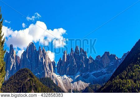 Magnificent Dolomites on a sunny autumn day. Europe, Val de Funes. Tyrol, Italy. Green forests in the Val de Funes