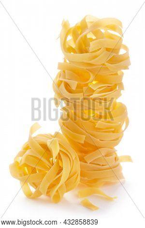 Fettuccine raw pasta italian food isolated on white background. Pasta tagliatelle at white