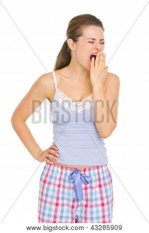 Young Woman In Pajamas Yawing