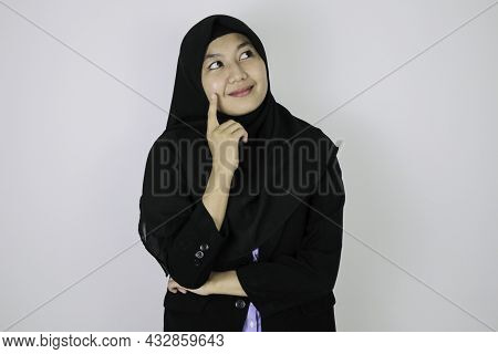Happy And Daydreaming Gesture Young Asian Islam Woman Wearing Headscarf.