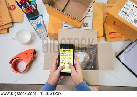 Selective Focus. Smartphone On Hand Of Business Woman Owner Using Application Shipping Service For C