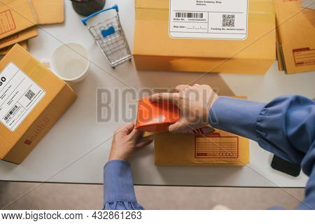 Top View Worker Sealing Cardboard Box With Adhesive Roll Tape Packing Product Ecommerce Shipping Ord
