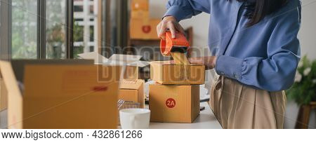 Web Banner Closeup Female Sealing Cardboard Box With Adhesive Tape Packing Product Ecommerce Shippin