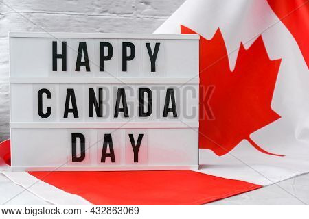 The National Flag Of Canada. Lightbox With Text Happy Canada Day Canadian Flag Or The Maple Leaf. Pa