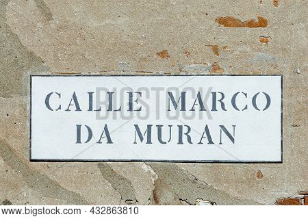 Signage Calle Marco Da Muran In Venice  At An Old Grunge House Wall