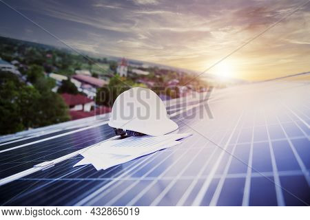Engineer Working On Checking Equipment In Solar Power Plantsolar Panel, Photovoltaic, Alternative El