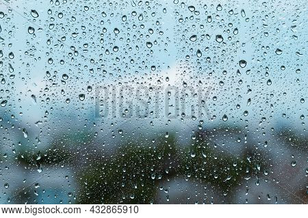 Rain Drop On Glass Window At Day Time In Monsoon Season With Blurred Background.