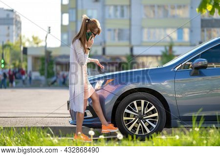 Helpless Woman Standing Near Her Broken Car Calling Road Service For Help. Young Female Driver Havin