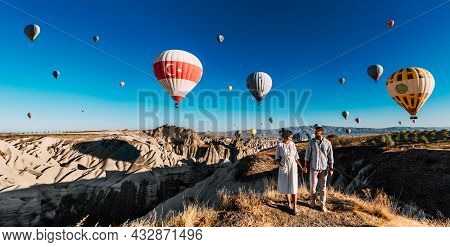 Travel To The Tourist Places Of Turkey. A Couple In Love Stands Against The Background Of Balloons I
