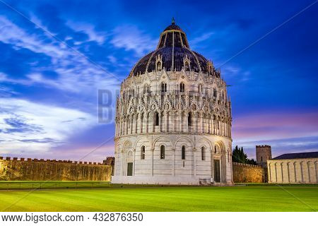Pisa, Italy. Sunset Twilight Colored Sky With Campo Dei Miracoli And Baptistery, Tuscany Travel Sigh