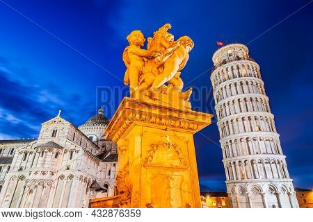 Pisa, Italy. Campo Dei Miracoli With Putti Fountaind And Leaning Tower, World Famous Attraction In T