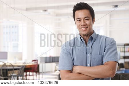 Portrait of happy young asian man at home in 30s, smiling. Copy Space.