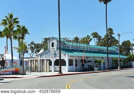 REDONDO BEACH, CALIFORNIA - 10 SEP 2021: Seaside Lagoon a seasonal spot for swimming, with a sandy beach, snack bar and play area