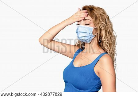 Young Woman Have Fever And Headache With A Medical Mask, Protection And Precaution For Contagious Di