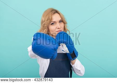 Woman In Cook Apron Punching Boxing Gloves, Boxer