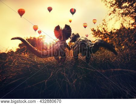 Two dinosaurs watching hot air balloons at sunset