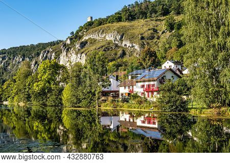 Idyllic Sunset View With Reflections Of Markt Essing With The Ruin Of Randeck Castle Over The River