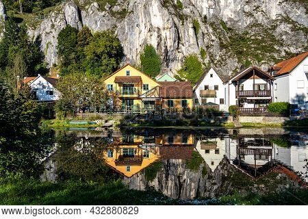 Idyllic Sunset View With Reflections Of Markt Essing At The River Altmuehl In Bavaria, Germany