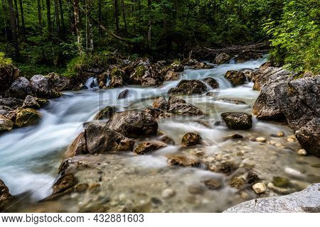 Magic Forest Zauberwald At Lake Hintersee With Creek Ramsauer Ache. National Park Berchtesgadener La