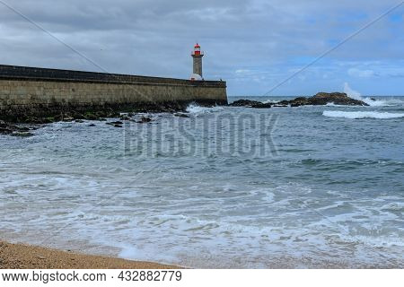 Felgueiras Lighthouse On A Breakwater Of Foz Do Douro District Of Porto City, Second Largest City In