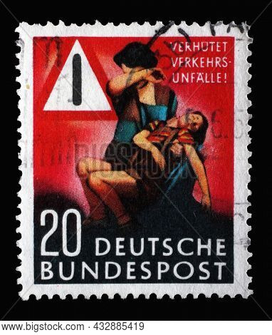 ZAGREB, CROATIA - JUNE 25, 2014: Stamp printed in Germany, shows Mother with injured boy, traffic sign, circa 1953