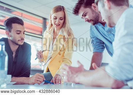 Business team negotiating an agreement