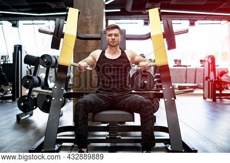 Strong Handsome Bodybuilder Working In The Gym. Muscular Athletic Man Training Hard.