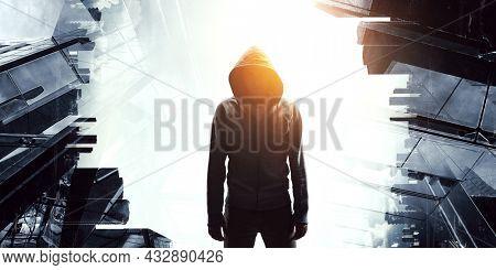 Silhouette of man in hoody . Mixed media