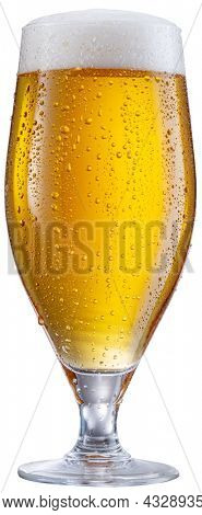 Glass of pale lager beer with water drops on cold glass surface isolated on white background. File contains clipping path.