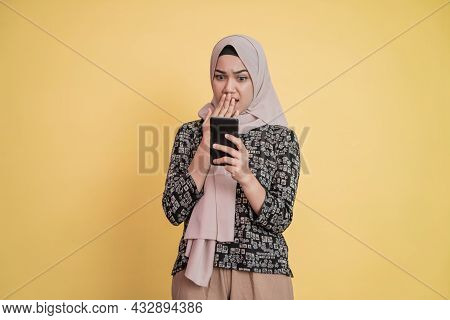 Close Up Of A Woman In Veil Using A Mobile Phone Shocked When She Sees A Mobile Phone Screen With Co