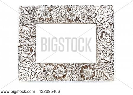 Empty shabby chic wooden photo frame, isolated on white.  Floral style.