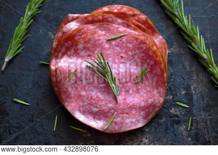 Salami Slices With Rosemary On A Metal Tray. Selective Focus.