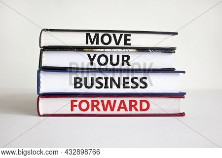 Move Your Business Forward Symbol. Concept Words 'move Your Business Forward' On Books On A Beautifu
