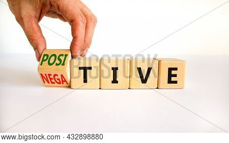 Positive Or Negative Symbol. Businessman Turns A Wooden Cube, Changes The Word 'negative' To 'positi