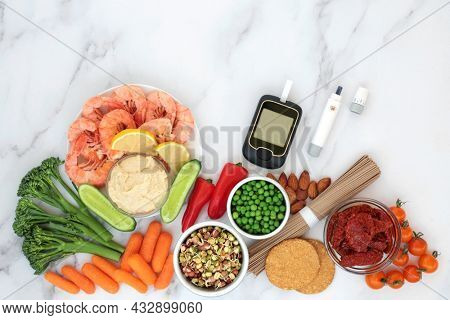 Low glycemic diabetic health food with blood sugar testing equipment with foods all below 55 on the GI index and high in antioxidants, omega 3, protein, lycopenes, anthocyanins, vitamins.