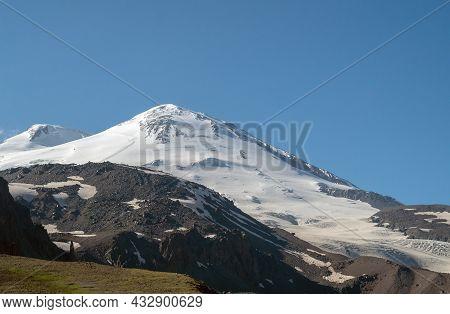 The Caucasian Mountain Range. Perspective Of Caucasian Snow Mountain Or Volcano Elbrus. Landscape Vi